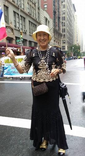 Community leader for seniors, Consuelo Almonte dons a black Filipiana.